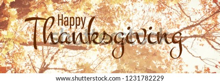 Illustration of happy thanksgiving day text greeting against  low angle view of tree against blue sky