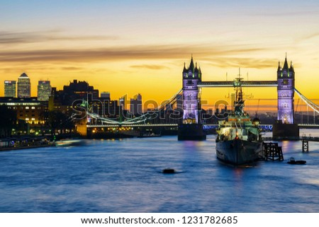 London, England - January 20 2017: A beautiful view looking at Tower bridge in London at sunrise. #1231782685