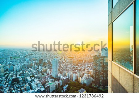 Asia Business concept for real estate and corporate construction - panoramic modern city skyline aerial view of shinjuku area under twilight sky and dramatic sunset in Tokyo, Japan