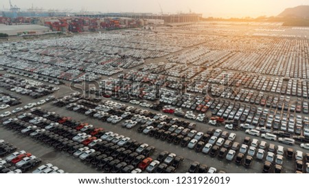 Aerial view top view a lot of car for import and export shipping to dealership.