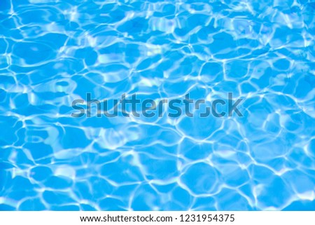 Water in swimming pool blue background #1231954375
