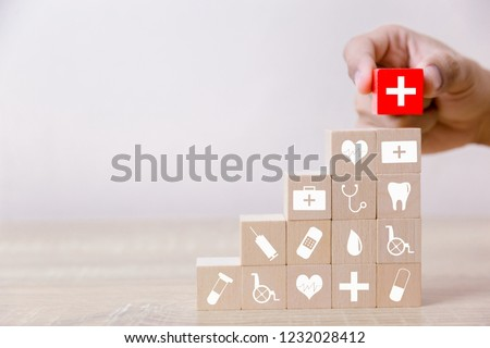 Health Insurance Concept,hand arranging wood block stacking with icon healthcare medical. #1232028412
