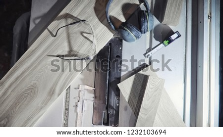 workshop with tools and electric saws in the process of manufacturing parts