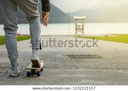 Skateboarding down by the lake in front of the mountains.Holiday.Christmas #1232121157