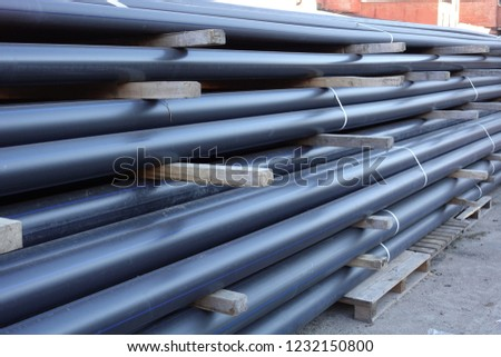 Plastic pipes in stock of finished products stacked in packs #1232150800
