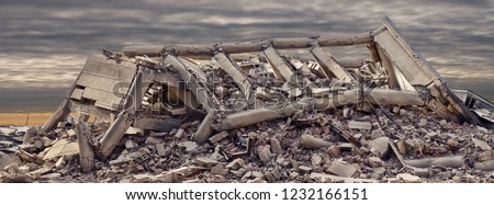 Collapsed concrete industrial building with dramatic sky in background. Disaster scene full of debris, dust and damaged house. #1232166151