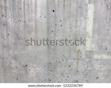 Raw concrete texture with some white stripes paint #1232236789