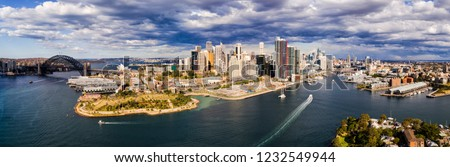 Aerial panorama of Sydney City architecture between the SYdney Harbour bridge and Pyrmont on a sunny day. #1232549944