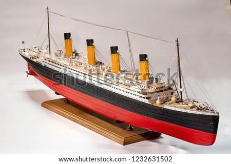 Handmade model of Titanic. Beautiful Handmade model of Titanic isolated on white background.  Royalty-Free Stock Photo #1232631502