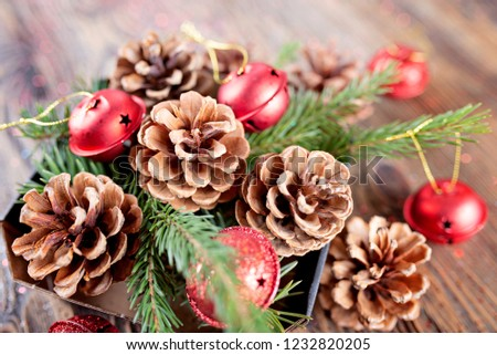 Christmas composition from branches of spruce and tree cones on a wooden background. Rustic style. Bokeh. Shallow DOF #1232820205