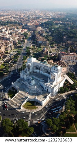 Aerial drone view of iconic neoclassic building of Altar of the Fatherland, known as the national Monument to Victor Emmanuel II, ancient Roman Forum and Colosseum at the background, Rome, Italy #1232923633