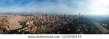 Aerial drone bird's eye panoramic view of iconic and beautiful Altar of the Fatherland monument, ancient ruins of Roman Forum and beautiful Colosseum at the background, Rome, Italy #1232930119