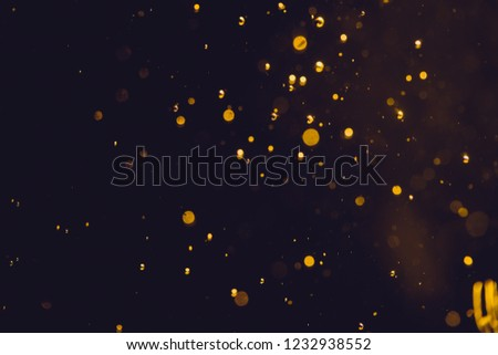 Dark Abstract Gold bokeh sparkle on black background #1232938552