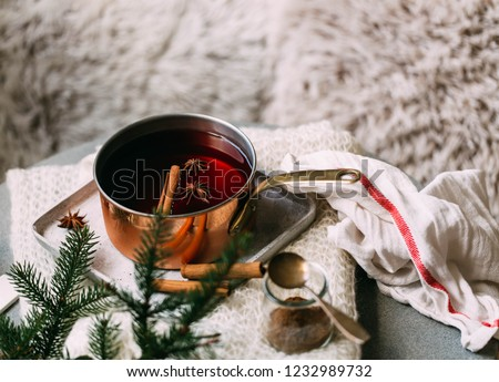 Non-alcoholic mulled wine with lemon and cinnamon in glass, flat lay #1232989732