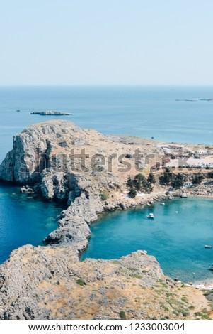 LINDOS, RHODES, GREECE - CIRCA JUNE 2018: panoramic view of St Paul's Bay in Lindos and Mediterranean Sea, Rhodes island of Greece. #1233003004