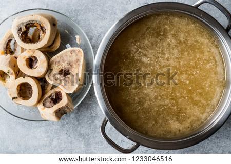 Bone Broth Bouillon in Metal Pan. Royalty-Free Stock Photo #1233046516