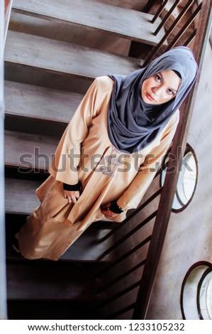 Beautiful Muslim girl wearing hijab and casual dress outdoor.Hijab fashion on the street. #1233105232