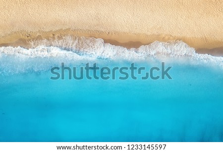Beach and waves from top view. Turquoise water background from top view. Summer seascape from air. Top view from drone. Travel concept and idea #1233145597