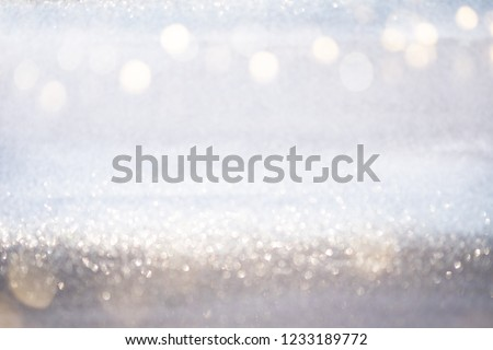 Abstract silver glitter bokeh lights with soft light background. #1233189772