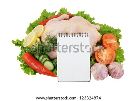 Raw chicken with vegetables with blank paper page isolated on white background #123324874