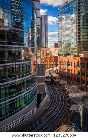 Two CTA trains passing each other in downtown Chicago #1233270634