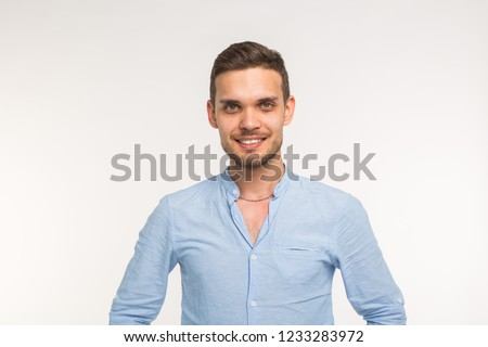Confident young handsome man smiling on white background #1233283972