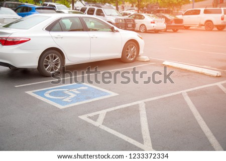 Free space Handicapped parking spot in motel or apartment, transportation infrastructure road markings. #1233372334
