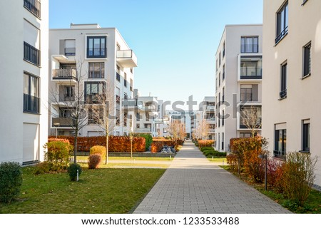Cityscape with residential buildings in late autumn #1233533488