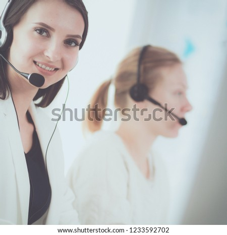 Attractive business woman working on laptop at office. Business people #1233592702