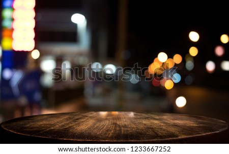 Selective Empty wooden table in front of abstract blurred festive light background with light spots and bokeh for product montage display of product. #1233667252