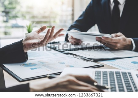 Finance manager meeting discussing company growth project success financial statistics, professional investor working start up project for strategy plan with document, laptop and digital tablet. #1233667321