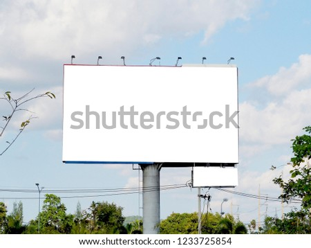 Blank billboard on blue sky background for new advertisement #1233725854