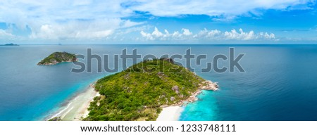 Vacation travel holiday recreation on beach concept.  Tropical Seychelles aerial panorama of island in sea. Vacation concept.  #1233748111