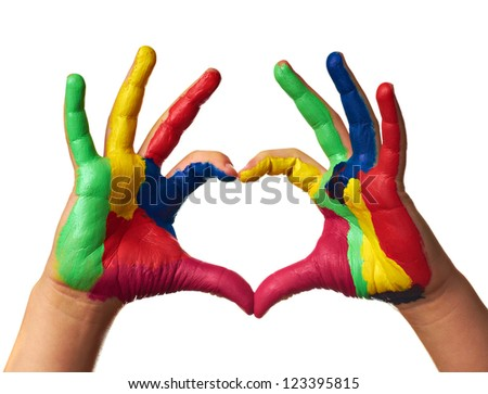 child hands painted make a heart shape