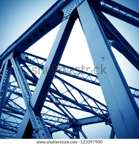 Support above the bridge, steel structure close-up. Royalty-Free Stock Photo #123397900