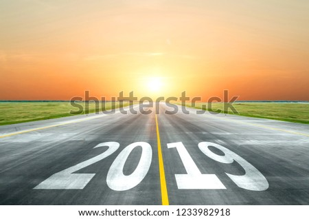View of the peaceful open road against the setting sun forward to new 2019 year. Concept of success in the future #1233982918