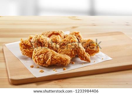 crispy fried chicken in a wooden table #1233984406
