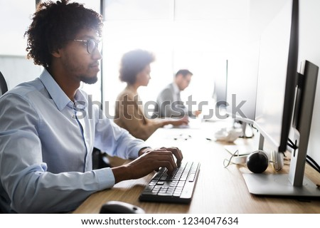 Programmers cooperating at IT company developing apps #1234047634