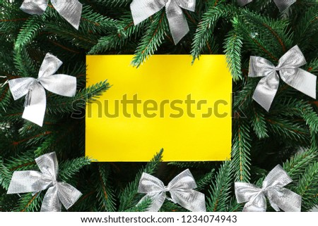 Blank paper sheet with fir tree branches and bows #1234074943