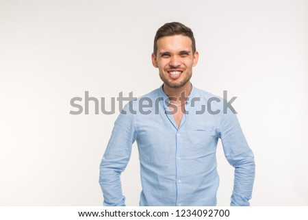 Funny young handsome man smiling on white background with copy space #1234092700