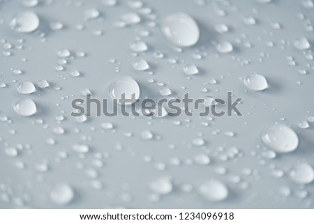 Water droplet on the car hood. Water beading after rain or car wash on white shiny paint surface. Beading created by ceramic coat or paint sealant with high surface tension. Water drop Backgroud. #1234096918