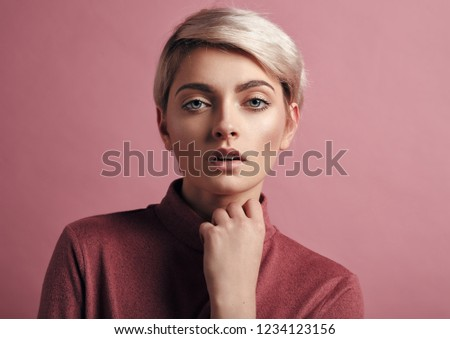 Portrait of fashion woman with blond short hair isolated on pink background #1234123156