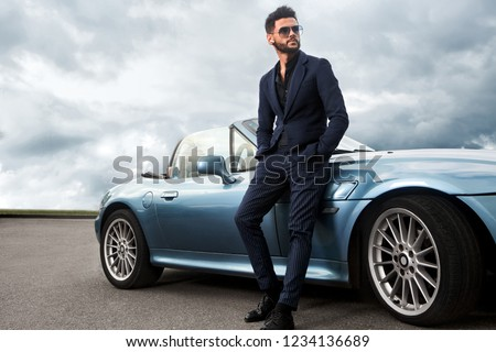 Successful, handsome man near the car. #1234136689
