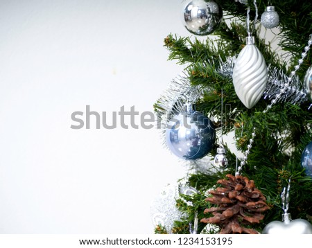 Christmas tree adorned with balls and stars, silver and blue, white background #1234153195