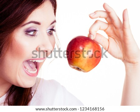 Woman holding red apple fruit in hand close to face, smiling, isolated on white. Healthy eating, high fibre diet concept. #1234168156