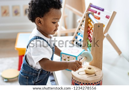 Young boy playing with educational toys Royalty-Free Stock Photo #1234278556