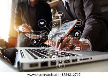 Working team meeting concept, business using laptop and smart phone and digital tablet computer with digital marketing media  in virtual icon network diagram office in morning light  #1234312717