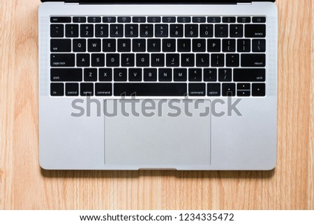 Top view keyboard notebook on wooden table background #1234335472