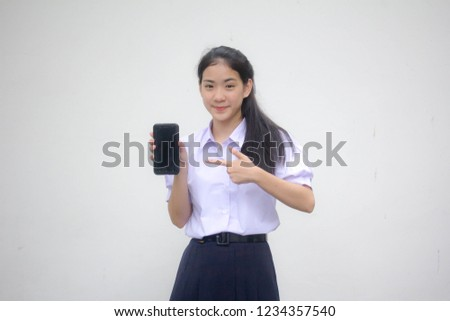 Portrait of thai high school student uniform teen beautiful girl show her phone #1234357540