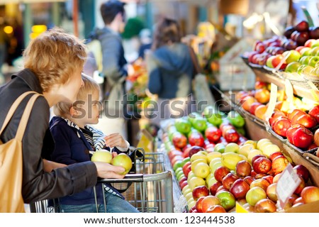 mother and her son buying fruits at a farmers market #123444538